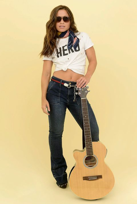 Musical instrument, Sleeve, Denim, Acoustic guitar, Guitar, Jeans, Musical instrument accessory, String instrument, Plucked string instruments, String instrument,