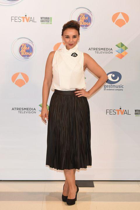 Clothing, Sleeve, Shoulder, Joint, Waist, Style, Orange, Logo, Fashion, Neck,