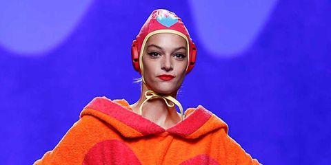 Lip, Headgear, Lipstick, Electric blue, Costume design, Costume, Hair accessory, Makeover, Eye liner, Headpiece,