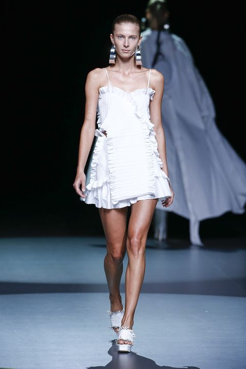 Fashion show, Shoulder, Dress, Human leg, Runway, Fashion model, Style, One-piece garment, Waist, Beauty,