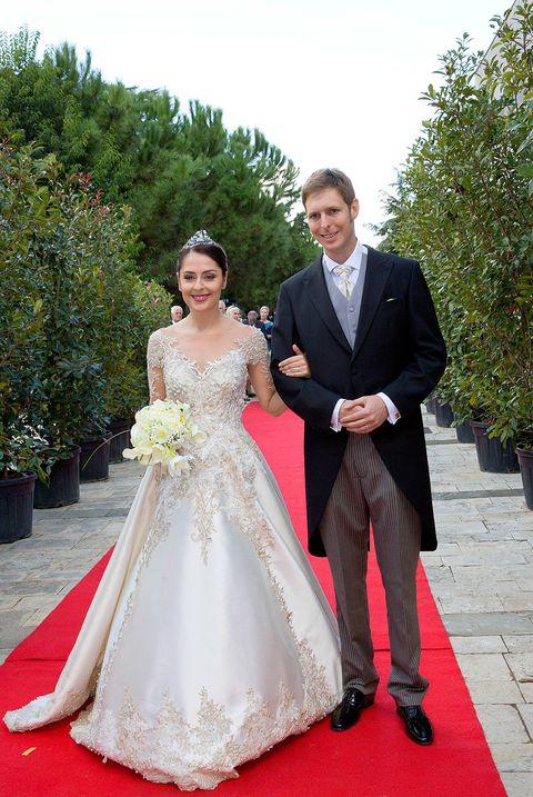 Clothing, Coat, Trousers, Dress, Shirt, Textile, Photograph, Bridal clothing, Outerwear, Suit,