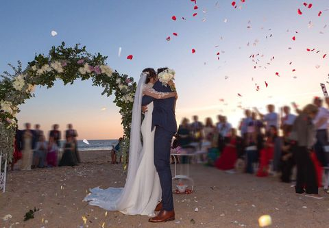 Dress, Event, Bridal clothing, Photograph, Red, Coat, Happy, Wedding dress, Bride, Suit,