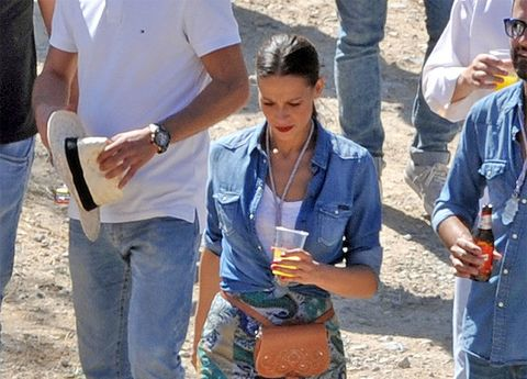 Denim, Jeans, Drink, Sharing, Watch, Drinking, Goggles, Belt, Wine glass, Alcohol,