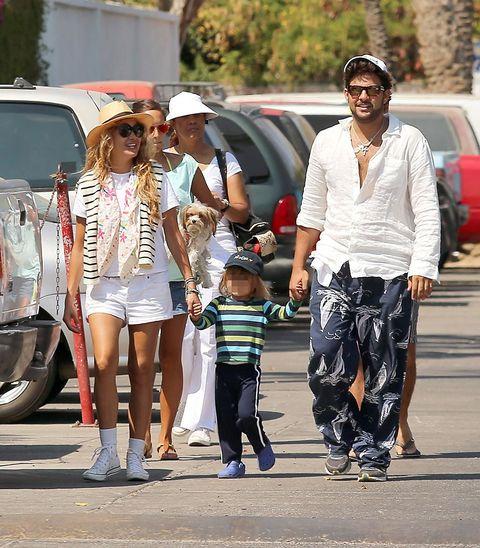 Clothing, Footwear, Leg, Land vehicle, Trousers, Shirt, T-shirt, Fender, Street fashion, Street,