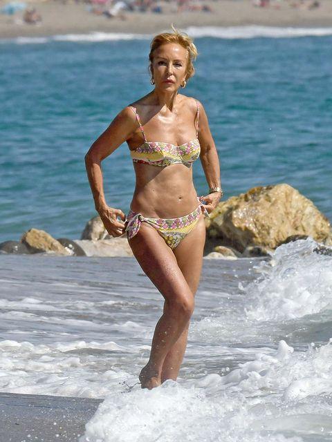 Body of water, Fun, Brassiere, Water, Human leg, Swimwear, Swimsuit top, Summer, Chest, Bikini,
