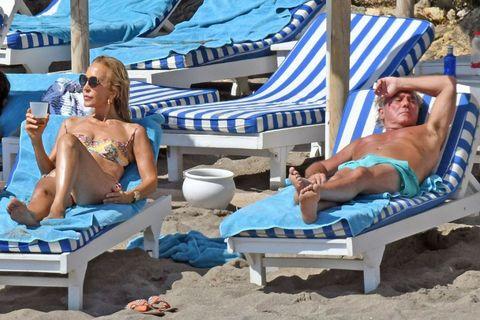Leg, Sitting, Leisure, Comfort, Summer, Sun tanning, Swimwear, Chest, Toe, Outdoor furniture,