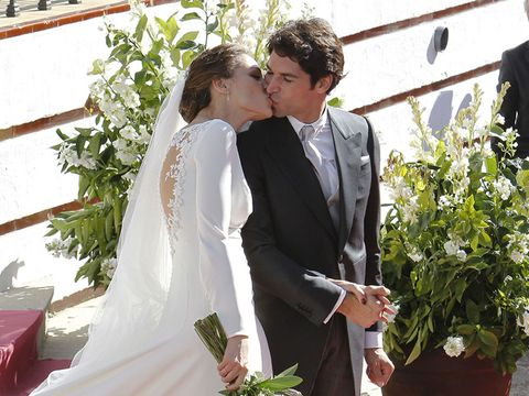 Clothing, Coat, Kiss, Photograph, Suit, Outerwear, Happy, Bridal clothing, Formal wear, Bride,