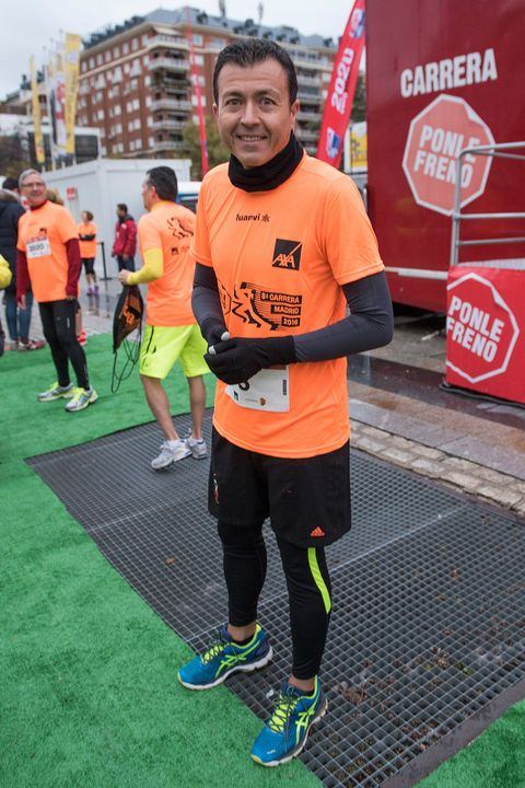 Footwear, Active shorts, Athletic shoe, Sportswear, Jersey, Shorts, Logo, Running, Orange, Athlete,