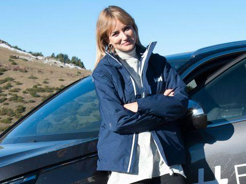Automotive design, Jacket, Automotive exterior, Vehicle door, Windshield, Electric blue, Automotive window part, Street fashion, Blond, Luxury vehicle,