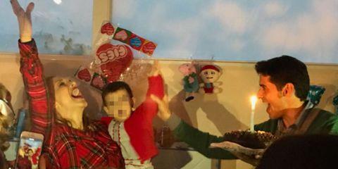 People, Fun, Social group, Interaction, Holiday, Sharing, Toy, Plaid, Christmas, Tartan,