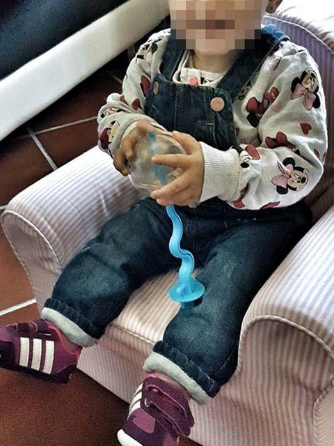 Sock, Drinkware, Boot, Lap, Plastic bottle, Ankle, Button,