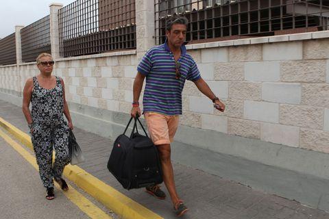 Bag, Luggage and bags, Dress, Street fashion, Travel, Snapshot, Baggage, Concrete, Bermuda shorts, Walking,