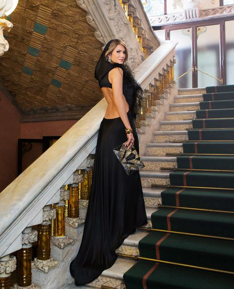 Stairs, Style, Formal wear, Drink, Dress, Street fashion, Waist, Fashion model, Gown, Alcoholic beverage,