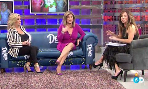Hair, Face, Leg, Sitting, Television presenter, Purple, Newscaster, Dress, Television program, Violet,