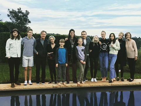 Social group, Jeans, Leisure, Team, People in nature, Jacket, Friendship, Denim, Reflection, Crew,