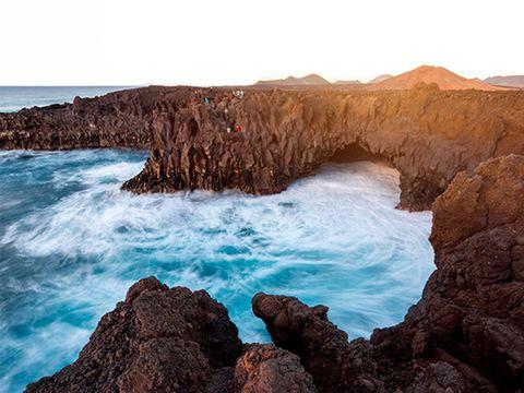 Body of water, Coastal and oceanic landforms, Rock, Ocean, Formation, Terrain, Bedrock, Geology, Coast, Azure,