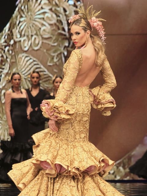 Clothing, Human, Dress, Formal wear, Gown, Style, Costume design, Fashion model, Fashion, Beauty,