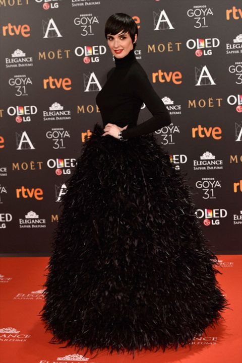 Hairstyle, Style, Black hair, Costume accessory, Fashion, Black, Eyelash, Long hair, Costume, Gown,