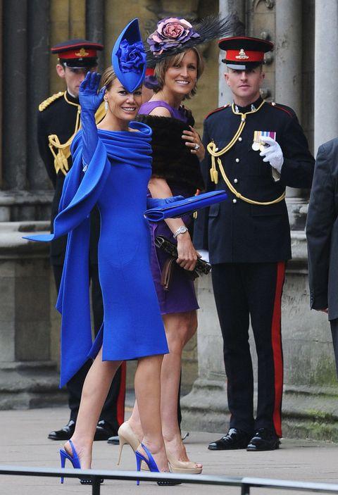 Uniform, Hat, Electric blue, Headgear, Costume accessory, Cobalt blue, Dress, High heels, Costume hat, Flag,
