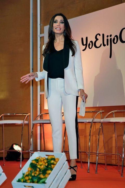 Blazer, Pantsuit, Suit trousers, Carpet, Stage, Orator,