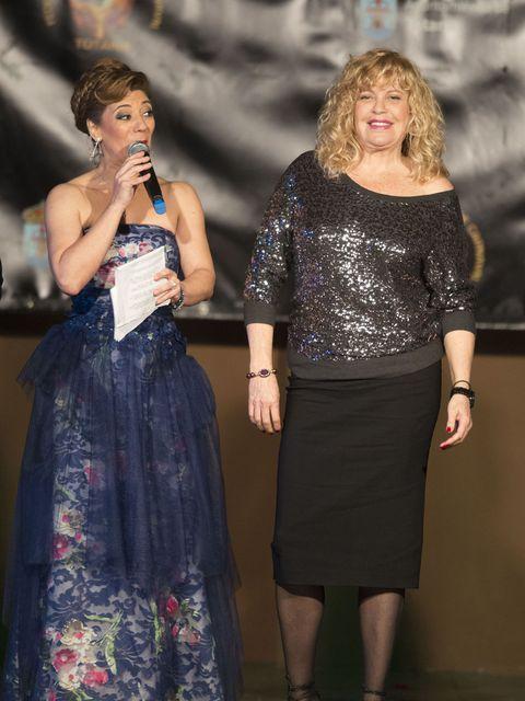 Clothing, Microphone, Entertainment, Dress, Singing, Fashion, One-piece garment, Waist, Day dress, Singer,