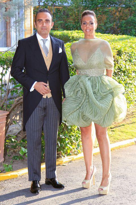 Clothing, Leg, Coat, Trousers, Dress, Shirt, Textile, Suit trousers, Outerwear, Standing,