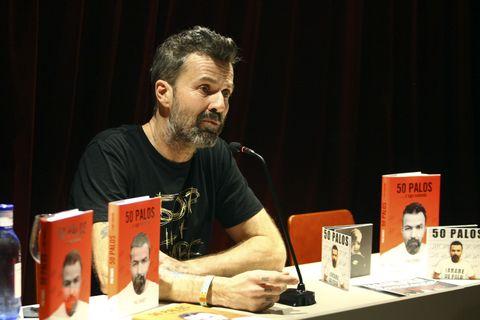 Facial hair, Shirt, T-shirt, Beard, Plastic bottle, Publication, Bottle, Moustache, Curtain, Book,