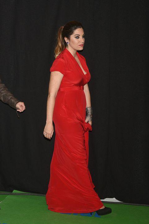 Clothing, Dress, Carpet, Red carpet, Gown, Formal wear, Fashion, Shoulder, Flooring, Fashion model,