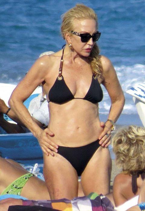 Bikini, Undergarment, Swimwear, Clothing, Swimsuit top, Swimsuit bottom, Sun tanning, Vacation, Summer, Surfer hair,