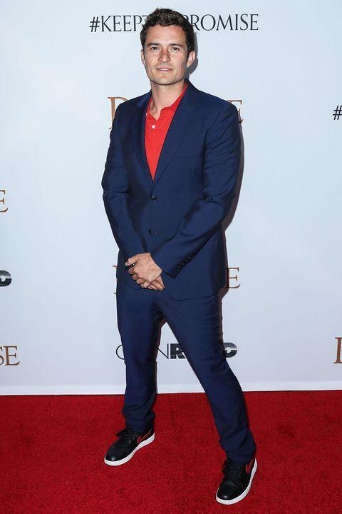 Suit, Carpet, Red carpet, Clothing, Formal wear, Standing, Tuxedo, Blazer, Outerwear, Flooring,