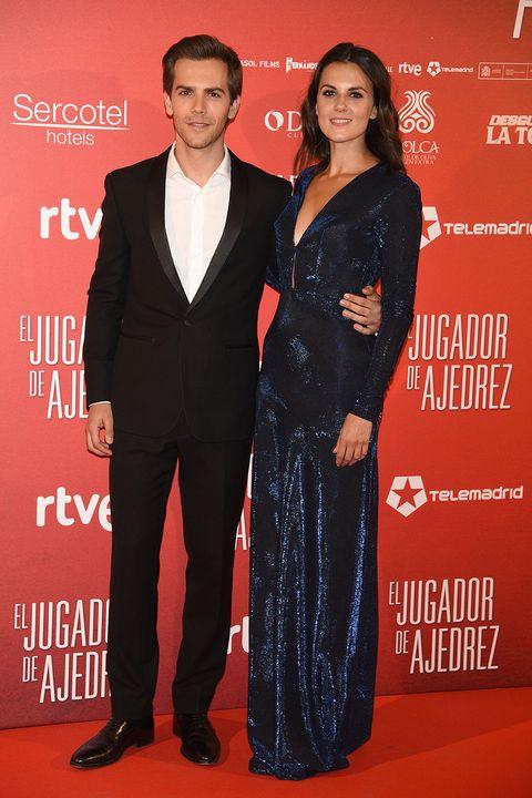 Premiere, Carpet, Red carpet, Suit, Formal wear, Event, Dress, Tuxedo, Flooring, Award,