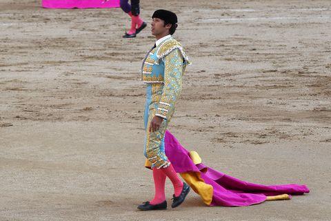 Matador, Bullfighting, Sport venue, Performance, Entertainment, Bullring, Tradition, Public event, Animal sports, Pink,