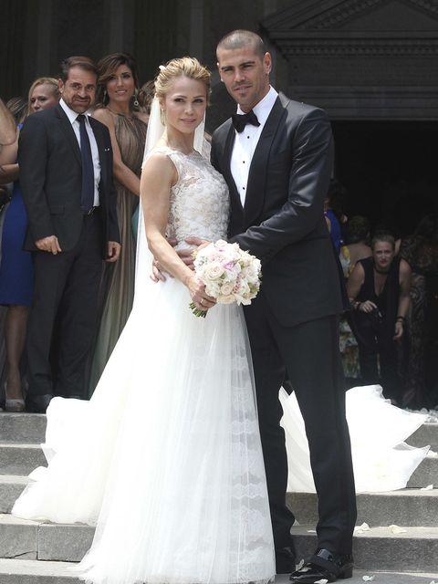 Gown, Wedding dress, Bride, Dress, Photograph, Bridal clothing, Ceremony, Facial expression, Wedding, Formal wear,