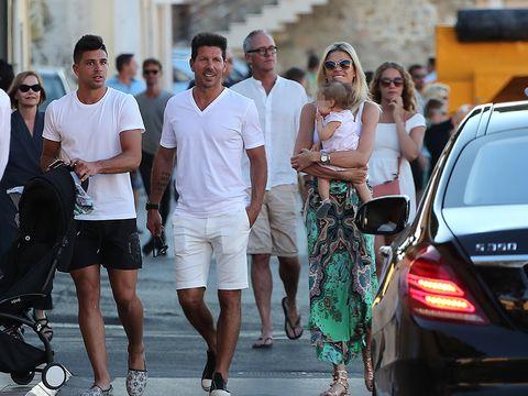 People, Street fashion, Fashion, Luxury vehicle, Pedestrian, Vehicle, Eyewear, Car, Sunglasses, Footwear,