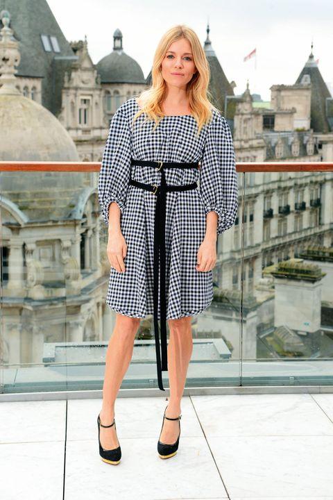 Clothing, Street fashion, Fashion, Dress, Pattern, Shoulder, Footwear, Fashion model, Design, Outerwear,