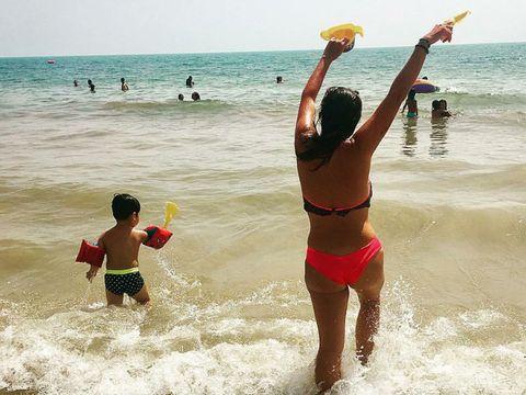 Body of water, Fun, Water, Swimwear, Standing, Leisure, Brassiere, Beach, Summer, Swimsuit top,