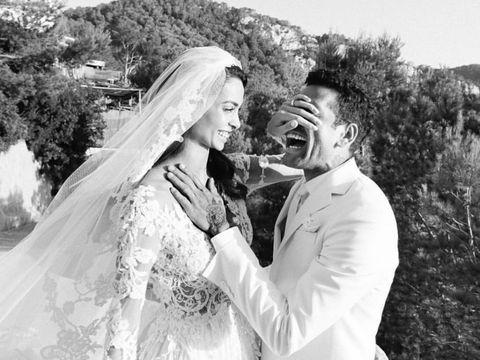Bridal veil, Veil, Bridal clothing, Photograph, Outerwear, Coat, Wedding dress, Happy, Bride, Formal wear,
