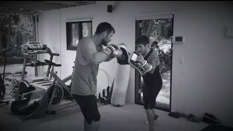 Photograph, Shoulder, Arm, Punching bag, Boxing, Muscle, Photography, Room, Exercise equipment, Monochrome,