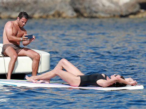 Sun tanning, Vacation, Blue, Beauty, Fun, Leisure, Summer, Leg, Barechested, Swimwear,