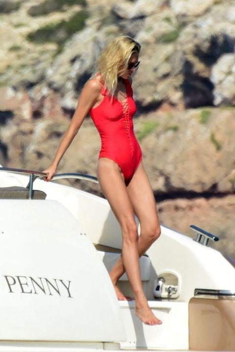 Human leg, Swimwear, Summer, Watercraft, Boat, Thigh, One-piece swimsuit, Maillot, Leotard, Waist,