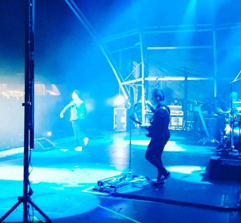 Performance, Entertainment, Stage, Concert, Performing arts, Blue, Rock concert, Public event, Performance art, Event,