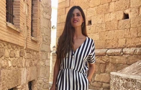 Clothing, Sleeve, Shoulder, Photograph, Dress, Wall, Brick, Style, Street fashion, Collar,