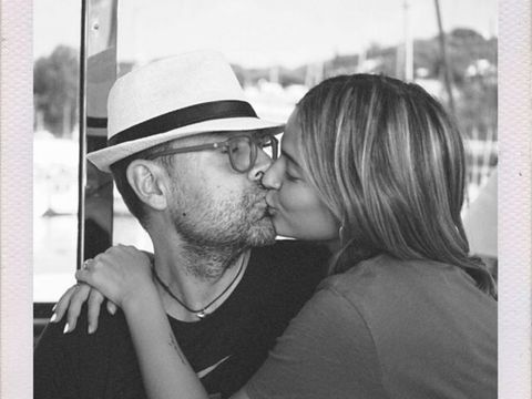 Clothing, Glasses, Lip, Hat, Photograph, Kiss, Style, Monochrome photography, Romance, Interaction,
