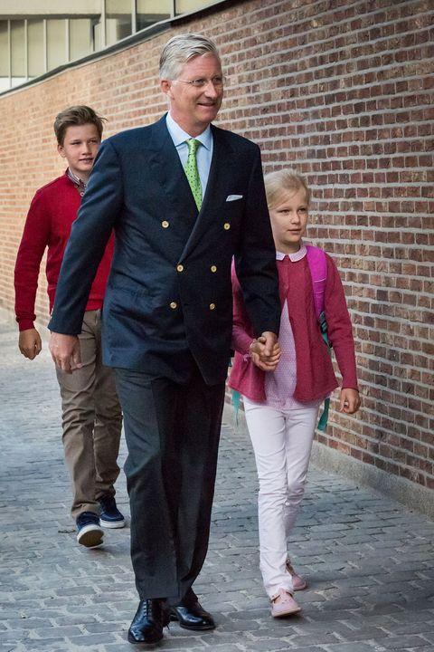 Suit, Clothing, Blazer, Formal wear, Outerwear, Standing, Fashion, Jacket, Tuxedo, Uniform,