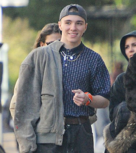 Face, Facial expression, People, Outerwear, Fur, Smile, Fashion, Standing, Street fashion, Beanie,