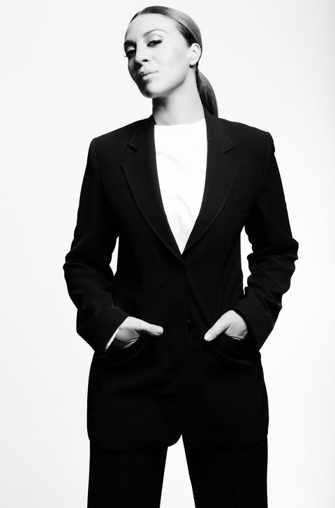 Suit, Black, White, Formal wear, Clothing, Standing, Model, Outerwear, Hairstyle, Blazer,