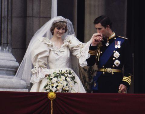 Bridal clothing, Bridal veil, Coat, Veil, Photograph, Outerwear, Gown, Formal wear, Bride, Wedding dress,