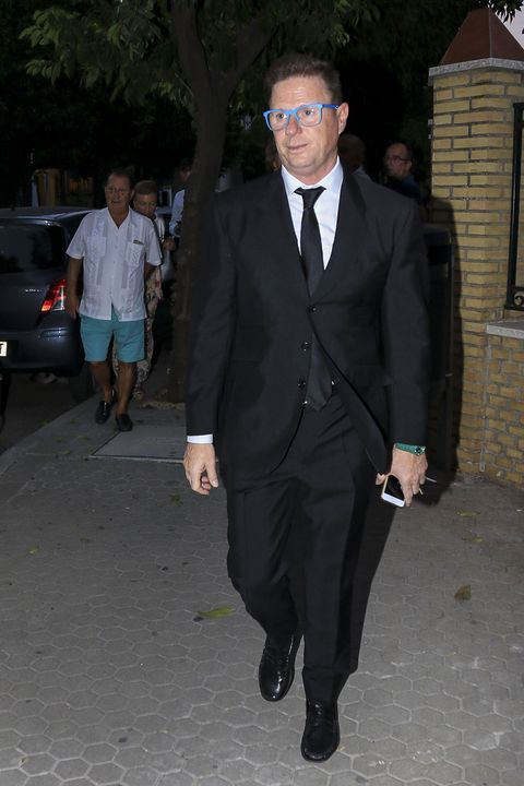 Suit, Formal wear, Clothing, Tuxedo, Blazer, Fashion, Outerwear, Dress shirt, Pantsuit, White-collar worker,