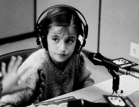 Headphones, Monochrome, Audio equipment, Black-and-white, Photography, Hearing, Technology, Telephone operator, Child, Electronic device,
