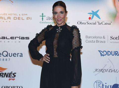 Suit, Fashion, Carpet, Formal wear, Dress, Little black dress, Outerwear, Fashion design, Event, Premiere,